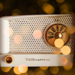 A White 1950 Westinghouse table top radio with a gold AM dial; photo has a filter of golden sparkle/lights